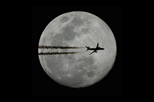 Plane in front of the moon